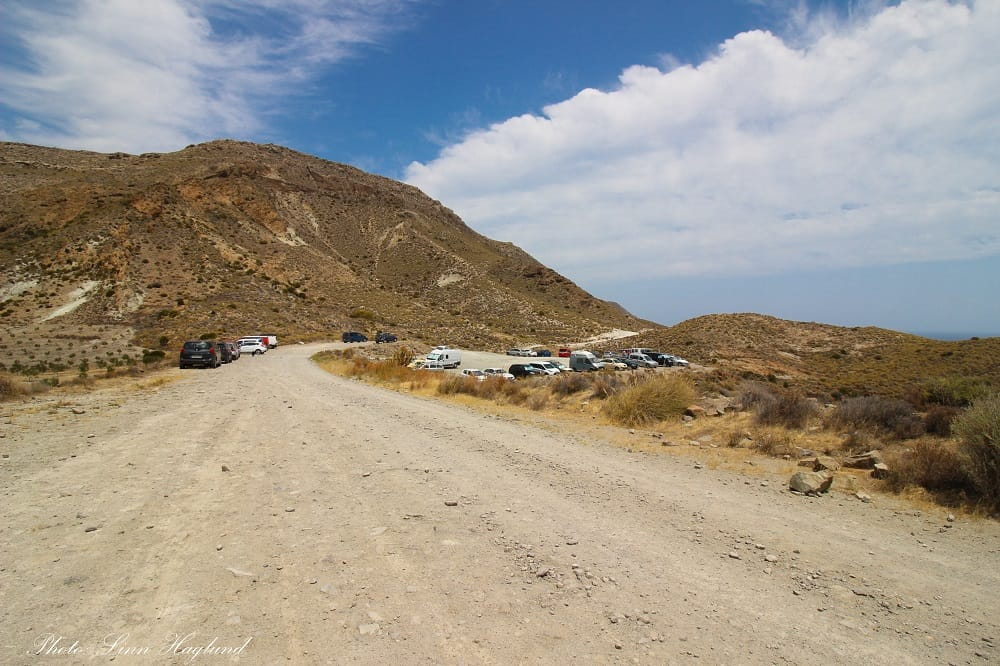 Where the dirt track meets the car park and the trail to Cala de San Pedro starts further ahead