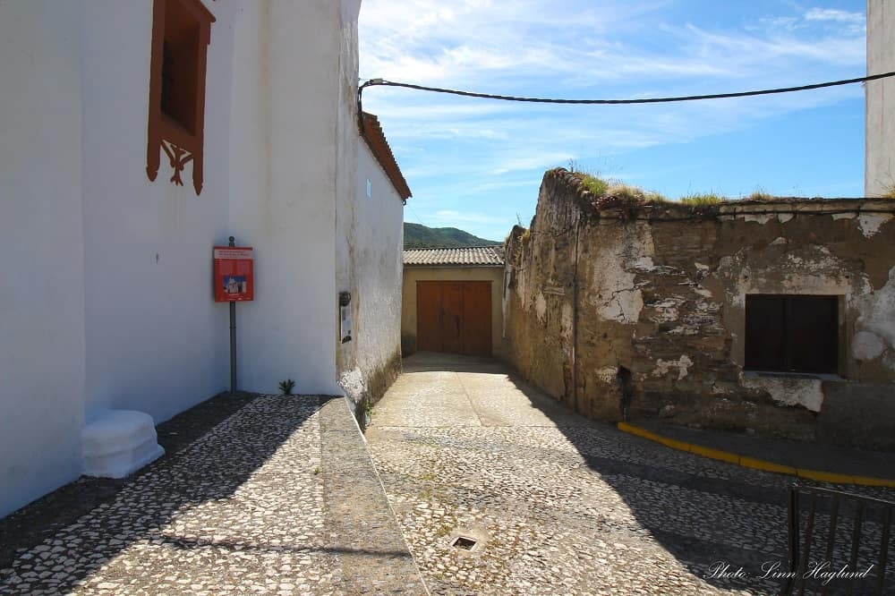 The street on the right side of the church where the walk to Bonales starts